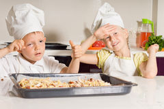 Little Chefs Tired from Baking Pizza Stock Image