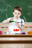 Little chemist conducts an experiment Royalty Free Stock Image