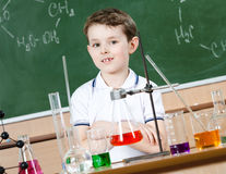 Little chemist is going to hold an experiment Royalty Free Stock Photography