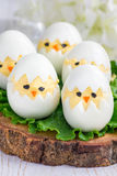 Little chicken in the nest, deviled eggs served with salad on wooden board, vertical Royalty Free Stock Images