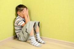 Little child. Boy wall corner punishment sitting Stock Image