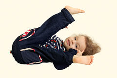 A little child. A little child demonstrates the flexibility Royalty Free Stock Images