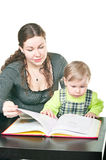 Little Child And Mother Learning Stock Photo