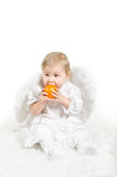 Little child an angel with orange fruit Royalty Free Stock Images