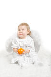 Little child an angel with orange fruit Stock Image