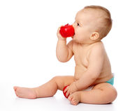Little child with apple Stock Image