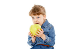 Little child with an apple. Royalty Free Stock Images