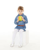 Little child with an apple. Royalty Free Stock Photo
