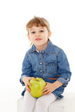 Little child with an apple. Stock Photo