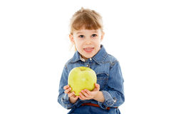 Little child with an apple. Royalty Free Stock Photos