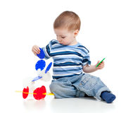 Little child assembling construction set Stock Photos