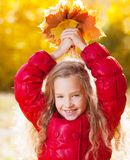 Little child at autumn Royalty Free Stock Images
