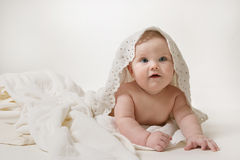 Little child baby. In white towel on white background Royalty Free Stock Image