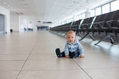 Little child, baby boy, playing at the airport, while waiting for his plane to departure. Springtime royalty free stock photo