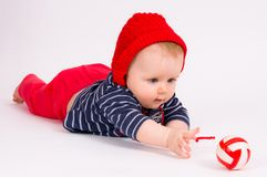 Little child baby crawling for the  ball Royalty Free Stock Photo