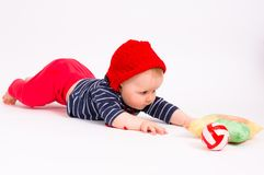 Little child baby crawling for the  ball Stock Image
