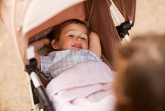 Little child or baby lying in stroller outdoors Royalty Free Stock Photos