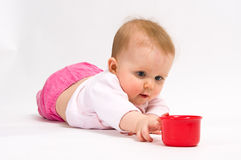 Little child baby and red cup Royalty Free Stock Images