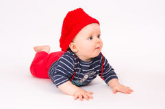 Little child baby in a red hat Royalty Free Stock Image