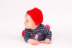 Little child baby in a red hat Stock Photo