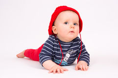 Little child baby in a red hat Stock Images