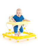 Little child in the baby walker. Royalty Free Stock Image
