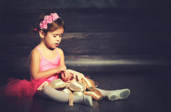 Little child ballerina with ballet pointe shoes and pink skirt t Royalty Free Stock Images