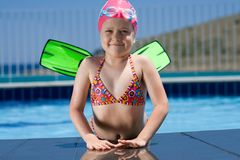 Little child in bathing cap, glasses, fins near sw Royalty Free Stock Photos