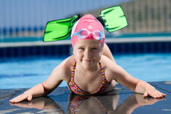 Little child in bathing cap, glasses, fins near sw Stock Photo