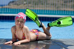 Little child in bathing cap, glasses, fins near sw Royalty Free Stock Photography