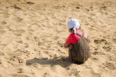 Little child on the beach is looking for shells Stock Photography