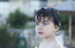 Little child on the beach with wet hair and body Royalty Free Stock Photography