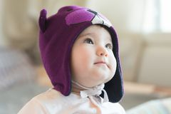 Little child in a beaver cap close up portrait Royalty Free Stock Photo