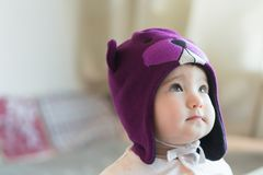 Little child in a beaver cap close up portrait Stock Image