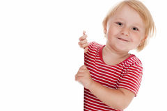 Little child behind white board Royalty Free Stock Images