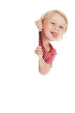 Little child behind white board. Photo shot of little child behind white board Royalty Free Stock Photo