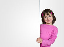 Little child behind white board Royalty Free Stock Photography