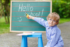 Little child at blackboard, Back to school concept. Royalty Free Stock Image