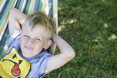 Little child blond  boy swinging and relaxing on a hammock Royalty Free Stock Photos
