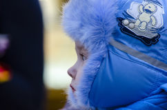 Little child in a blue winter hat. Portrait of little boy in winter time Stock Images