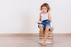 Little child with books. Stock Images