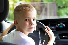 Little child boy behind the steering wheel of a car Royalty Free Stock Images