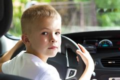 Little child boy behind the steering wheel of a car.  Royalty Free Stock Photos