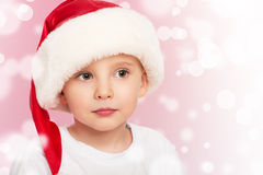 Little  child boy in a Christmas hat Stock Photography