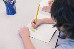 Little child boy drawing with colored pencils. Creative style. Little child boy drawing with colored pencils. Creative style royalty free stock photography
