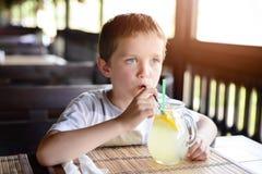 Little child boy enjoying his delicious lemonade Stock Photo