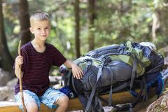 Little child boy with hikers backpack travelling in forest.  Stock Photo