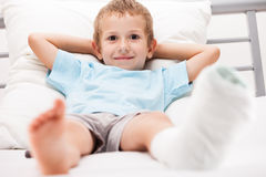 Little child boy with plaster bandage on leg heel fracture or br stock photos