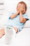 Little child boy with plaster bandage on leg heel fracture or br. Human healthcare and medicine concept - little child boy with plaster bandage on leg heel stock photo