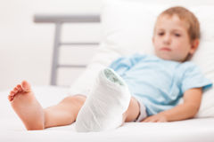Little child boy with plaster bandage on leg heel fracture or br. Human healthcare and medicine concept - little child boy with plaster bandage on leg heel Royalty Free Stock Images